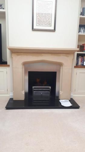 Client's Own Limestone Fireplace - Steel Back Panel; Quartz Fire Basket