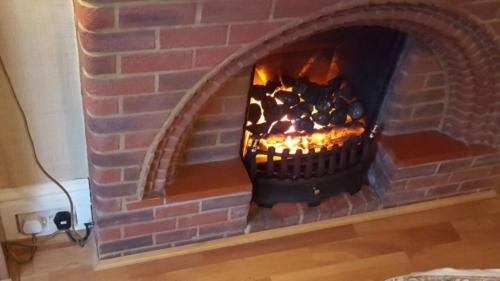 Electric Inset Fire (Reusing Client's existing Fireplace)